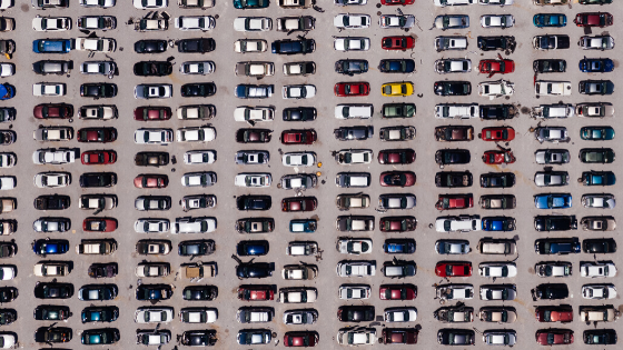 Overhead View Of Parking Lot Filled With Cars