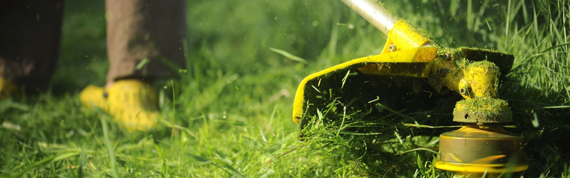 Closeup photo of weedwhacker doing commercial landscaping