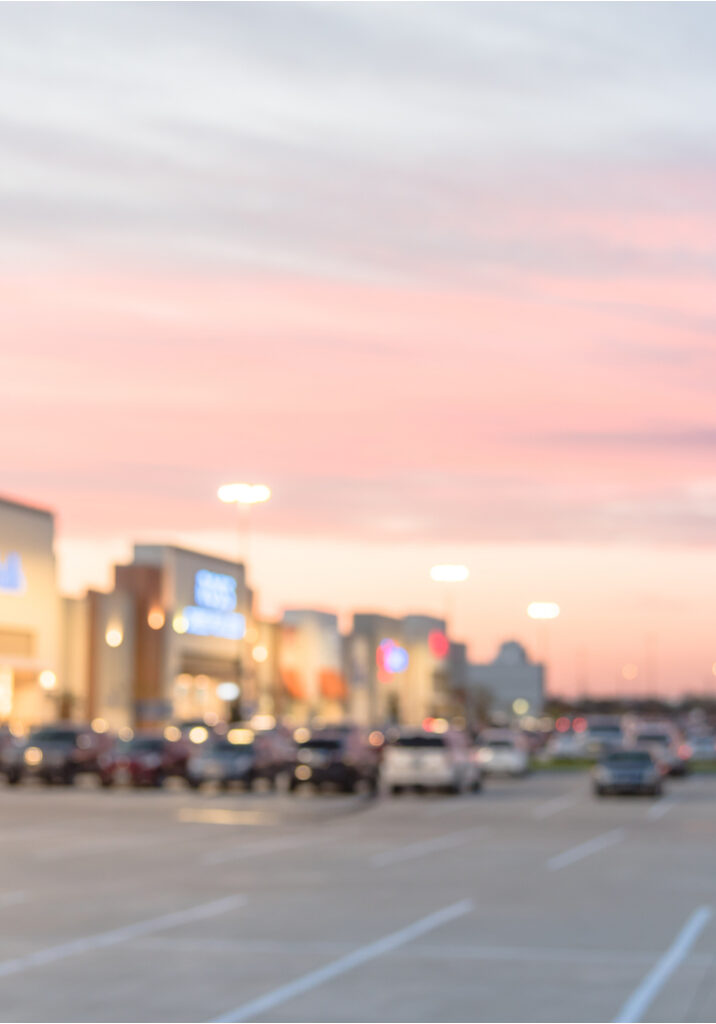 Blurred Stylized Photo Of A Shopping Mall Parking Lot
